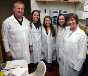 Undergraduate Jen Corcoran and graduate student Caleigh Guoynes on Family Lab Days